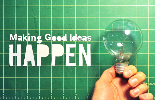 Making good ideas happen hand holding lightbulb